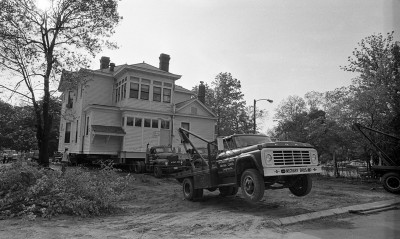 Tow trucks pull the Garland Tucker House backward toward Person Street. NO.5-12-1975.tuckerhsemove
